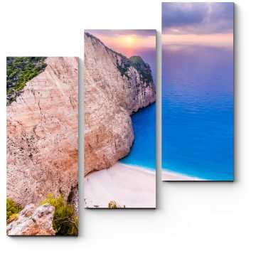 Закат на пляже Греции