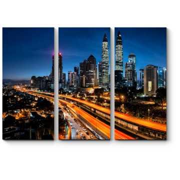 Пробуждающийся Куала-Лумпур на рассвете
