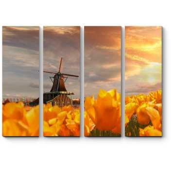 Ветряная мельница и желтые тюльпаны на закате
