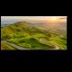 Извилистая дорога вдоль зеленых полей