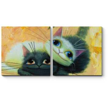 Серые котята играют