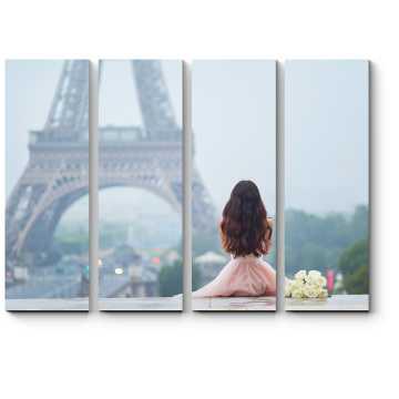 Сидя возле Эйфелевой башни